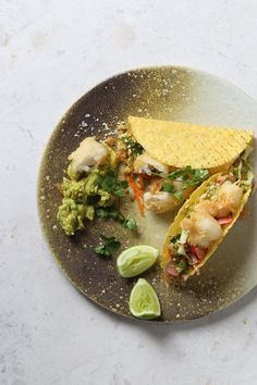 Nikkei Style Fish Tacos with Toasted Sesame Slaw and Guacamole is perfect party food, your guests won't be able to stop at one!