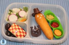 Bento for Kidlet: #Meatless Monday:  Cowboy Morningstar Farms corndog with ketchup, mustard, and soy crackers. On the side are grapes, a checkered apple, and salad.