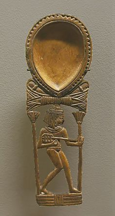 Egyptian spoon-18th Dynasty with a girl playing the Lute.