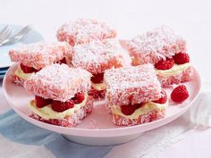 These raspberry delights are a cute creative twist on your classic lamingtons! They're dipped in pink icing and layered with cream cheese filling and fresh raspberries for a fun treat everyone will love.