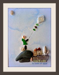 Pebble art with sea glasses