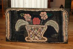19 th c  early hooked rug of a basket of flowers  hooked with strips of early fabrics