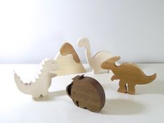 Set of handmade dinosaurs wooden toys and a anachronistic animal the wooly mammoth in a Waldorf style This baby toys is made from natural wood :