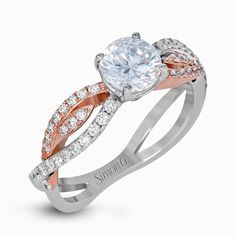 Showcasing a delicate swirl design, this two-tone engagement ring is set with .38 ctw of shimmering white diamonds. Print Page