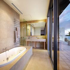 Tub with a view in the bathroom of this penthouse in Melbourne, Australia. Credit to agents: Kayne Lanyon and Sarah Wood of Marshall White.