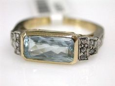 Vintage style aquamarine. Kinda like. Simple, elegant, detailed, pretty