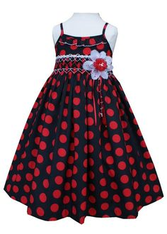 Our 'Stylish Black and Red Polka Dot Dress' is exactly that, stylish and adorable! Your little one will just love it. It has spaghetti straps, and under the neckline is a ruffle trimmed with white sca
