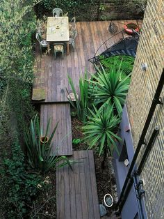 I love the look of decks puzzled together as a sort of varied boardwalk, bordered in grasses or other low-maintenance plantings.