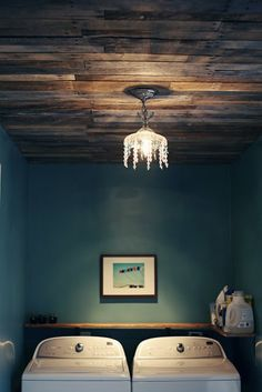{laundry room redo} Pallet ceiling with small chandelier in laundry room. DIY remodel, DIY makeover, #pallets, organizing, small space. See lots more creative pallet ideas at http://pinterest.com/wineinajug/passion-for-pallets/
