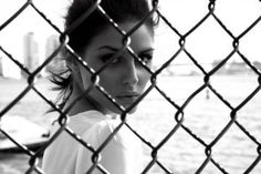 Behind the fence.