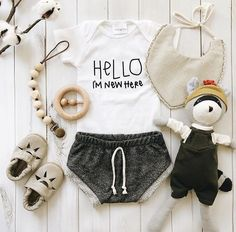 Baby flatlay | baby boy baby girl baby clothes | baby outfit | gender neutral baby clothes | hello I'm new here hello world | paci clip | wood teething toy | baby Mary Janes | terry cloth cotton shorts | organic baby clothes | hazel village | vintage style | fall summer spring winter | kids fashion outfit ideas | figs and foxes