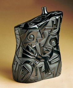 Carved pottery bottle by Tammy Garcia.