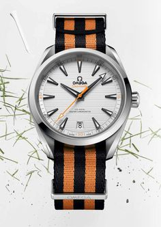 "The Omega Aqua Terra Golf watch with orange and black striped NATO strap is devoted to Omega's professional golf ""ambassador,"" Rory McIlRoy."