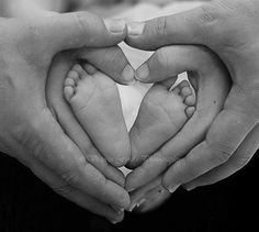 Cute Shot! I like to see the parent with new baby take the picture with feet make to look like the heart.