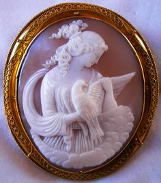 "Allegory of the Purity, ca. 1850, Italy, Frame could be English, sardonyx shell, 2 3/4"" by just over 2 3/8"", Depicting the Allegory of the Purity, a young maiden holding a dove, which is the symbol of the purity. There is an engraving on the frame, it reads Margt Emily Mather, maybe Margt stays for Margot. To write it the frame was cut and then replaced in its own place."