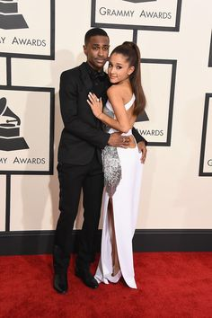 Ariana Grande and Big Sean show off some PDA at the 57th Annual Grammy Awards.