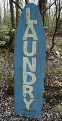 love this! laundry sign via vintage ironing board. i see this ironing boards at antique shops all the time! very FOLK!