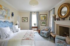 Bunny Williams' master bedroom in the 2015 Southern Living Idea House with a color palette of light blue and neutrals, and featuring her Botanical Framed Prints!