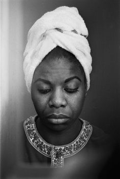 """""""A reflection of Nina Simone in a motel room mirror in Buffalo, New York. Photograph by © Alfred Wertheimer, 1964."""""""