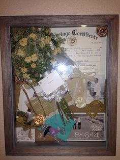 DIY post wedding shadow box. Great way to display & keep special memories/items safe and preserved. Also the wood & burlap frame fit my wedding theme perfect!! Las Vegas Stratosphere ticket-where Bubs proposed to me, STD, post stamp sized engagement picture calendar STD savers, invitation, envelop sticker, rehearsal floral headband, wedding bouquet/boutineer, garter, letter to Momma/momma's special memorable decal from Cake Topper, I love you more message from MOH, marriage certificate…