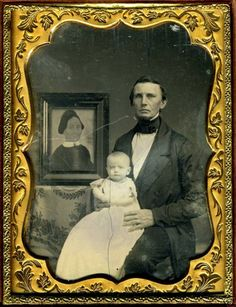 Striking mourning daguerreotype with a man, his baby and a folk art portrait of the deceased mother.
