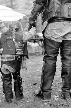 Daddy's little Motorcycle Girl wearing Leather Chaps and Leather Vest.
