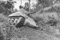 American M4 Sherman tank bogged down in the mud near Miturno during the campaign to drive German forces from Italy, 1944.