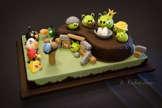 Angry Birds! - Birthday cake for my 8yo son.  Took me forever to get all of the figures done, but he was very specific in his list of characters!  I'm so pleased with how it turned out!  Base cake is a 12x18 sheet for size reference. Thanks for looking!  Comments and constructive criticism are always welcomed!