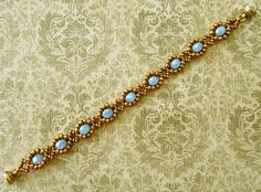 Linda's Crafty Inspirations: Bracelet of the Day: Lace Flowers Variation