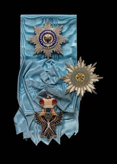 Imperial Russian Order of St Andrew with sash and set of breast stars (metal and embroidered badges.