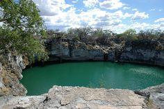 Otjikoto Lake is a sinkhole lake, created by a collapsing karst cave near Tsumeb, Namibia