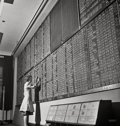 """January 1943. Chicago, Illinois. """"Mrs. Marie Griffith, manager of the information room, at one of the boards listing rates to points all over the country at the Union Station."""" Photo by Jack Delano, Office of War Information. Shorpy Historical Photo Archive"""