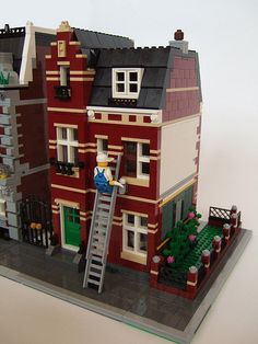 """""""The Dark Red House is being renovated."""" The Dark Red House is shown here with the Gravel Path to the left and the Dark Red Corner Garden to the right. Casa Lego, Lego Modular, Lego Worlds, Cool Lego Creations, Lego Design, Lego House, Lego Projects, Lego Building, Legoland"""