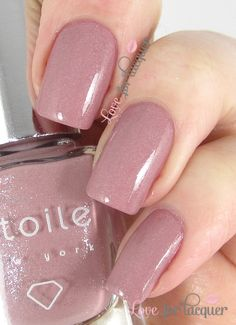 http://www.loveforlacquer.com/2014/01/etoile-nail-polish-swatches-gloss48.html Midnight Kiss - Soft mauve with diamond shimmer.