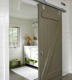grey taupe finish on bathroom barn door        via House Envy