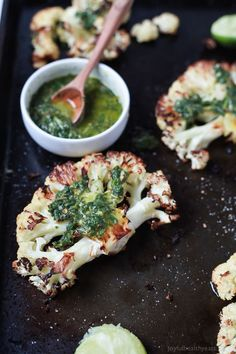 Easy naturally Gluten Free Roasted Cauliflower Steaks topped with fresh zesty Chimichurri Sauce at only 106 calories. Who knew Cauliflower could taste so good! This recipe is down right addicting! Have you tried Cauliflower Steaks before? I know I know... kinda confusing. How can Cauliflower be a Steak? Well, if you slice it a certain way it kinda looks like steak ... shape wise. It's basically like a vegetarians way of having 'steak' without the actual meat. Sneaky right? At fir...