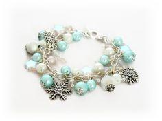 Snowflake Themed Pearl Charm Bracelet bespoke handmade jewellery by Lottieoflondon #bespoke #jewelry #jewellery #charmbracelet #bracelet #white #blue #xmas #Christmas #snowflake #pearl giftideas #winter