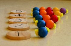 Montessori Math -- I've been assigning each number its own color do each column a different color to make the concept more clear.  (using pompons)