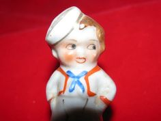 Hey, I found this really awesome Etsy listing at https://www.etsy.com/listing/105998910/vintage-sailor-boy-salt-shaker-navy