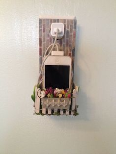 Unique Cell Phone Holder wall socket charging holder IPhone or Samsung Galaxy. Cell phone holster made in miniature dollhouse style - Phone Holder Geek Gifts For Him, Gifts For Husband, Phone Holster, Cell Phone Holder, Cute Purses, Cute Creatures, Flower Boxes, Vintage Handbags, Handmade Flowers