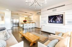 The open-concept kitchen gives way to the livingroom, combined the heart of the home