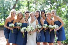 THIS color blue - love the white bouquets and love this style of posed shot - all the girls are hugged in tight, just showing a shoulder