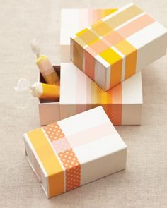 To take inexpensive boxes from basic to vibrant, wrap pieces of colorful adhesive around each, creating a graphic striped pattern. You can also use the tape to punch up plain pieces of bulk taffy -- or to cover a lackluster label.