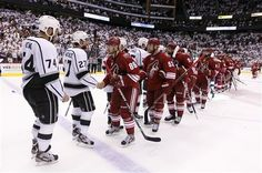 Kings and Coyotes line up for the congratulatory handshake after the Kings win the 2012 Western Conference final and the Clarence Campbell Trophy