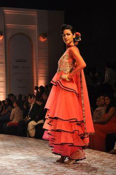 "A model showing Gaurav Gupta's collection ""Lightfall 2013"" at the Amby Valley India Bridal Fashion Week 2013. #Fashion #Style #Beauty"