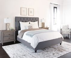 Grey upholstered fabric bed frame.  This stunner showcases hand-applied diamond tufting with full fabric folds, as well as individually-applied nail head accents. Durable steel slats also ensure extraordinary support while you're sleeping. Best of all, it's offered at a brag-worthy price.