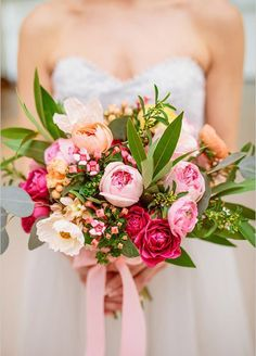 This colorful pink bouquet is perfect for your spring wedding!