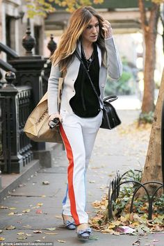 857be2fb436c Chic  The dark blonde beauty wore a pair of nude cigarette trousers with a  orange. Sarah Jessica ParkerJessica ...