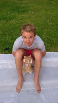 As a F1 nerd... this shot makes me really happy. Nico Rosberg and a cat. Enough said.