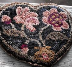 Peony Heart is a one of a kind hooked mat that I hooked and finished. This is a prototype piece for the Botanical Hearts patterns and is featured on the cover of the pattern set. This is my first peony motif that later begot other designs such as Peony Purse and Peony Pillow. Own a piece of Primitive Spirit history.  The 10 x 8 heart shaped mat is hooked with hand-dyed 100% wool fabric, and is finished with a sewn on wool backing with pinked edges. On the back I created a hand-stamped and…